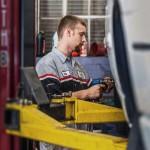 auto-mechanic-working-on-tire
